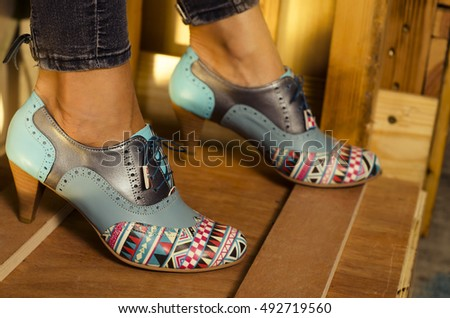 Closeup of fashionable handmade heels on wooden crates