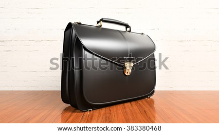 Closeup of fashionable leather briefcase on hardwood table - stock photo