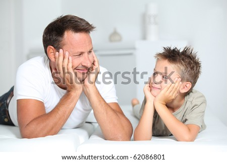 Closeup of father and son at home - stock photo