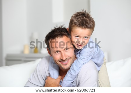 Closeup of father and son at home