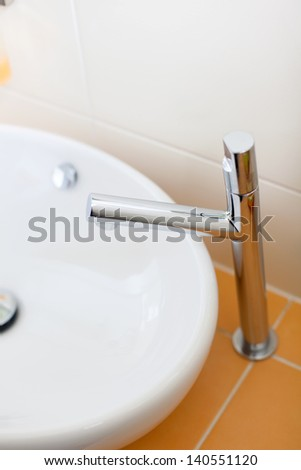 Closeup of faucet and sink in bathroom