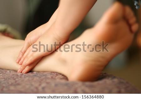 Closeup of feet receiving foot massage - stock photo
