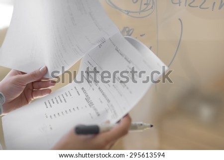Closeup of female doctor hands holding test results of her patient - stock photo