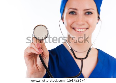 Closeup of female doctor's hand holding stethoscope over white background