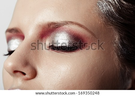 closeup of female eye with beautiful magenta make-up