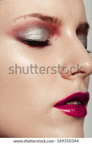 closeup of female eye with beautiful magenta make-up - stock photo