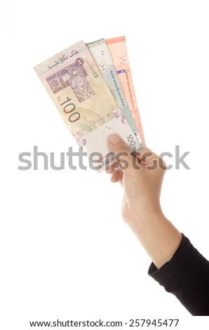 Closeup of female hand holding coins and bank notes, saving concept