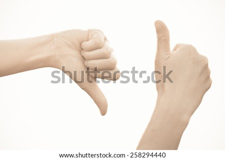 Closeup of female hand showing thumbs up sign against white background - stock photo