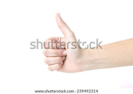 Closeup of female hand showing thumbs up sign against white background. Woman hand with thumb up Isolated on white