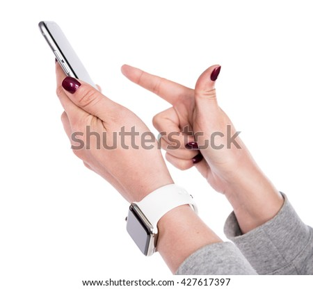 Closeup of female hand using a smart phone on a white background