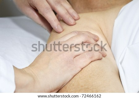 Closeup of female hands massaging arm and shoulder