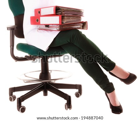 Closeup of female legs of woman in lab coat. Doctor with folders documents sitting on chair isolated on white. Paperwork in hospital. - stock photo