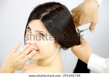 Closeup of female model laughing getting haircut