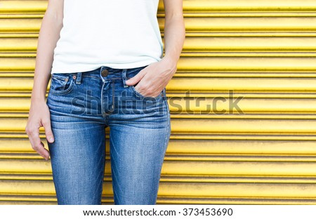 Closeup of female wearing jeans.  - stock photo