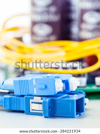 Closeup of fiber optic connector with Circuits board - stock photo