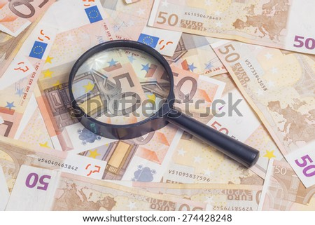 Closeup of fifty euro notes through magnifer background - stock photo