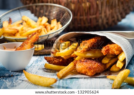 Closeup of Fish & Chips served in paper - stock photo