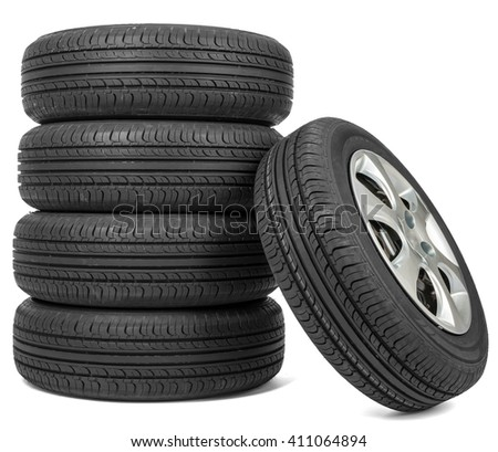 Closeup of five tires, isolated over white background - stock photo