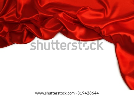Closeup of folds in red silk fabric on plain background.  - stock photo