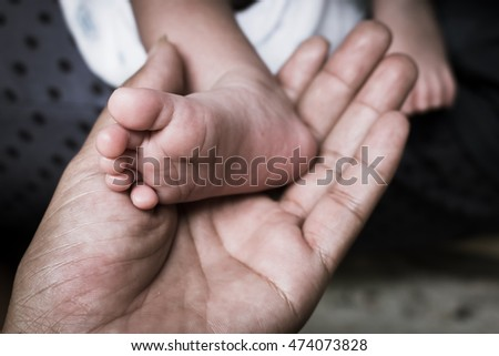 Closeup of food newborn in hand of mother,vintage