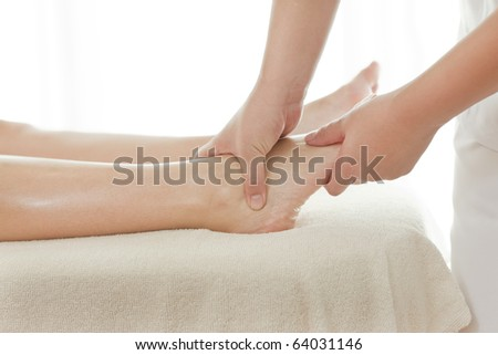 Closeup of foot receiving massage