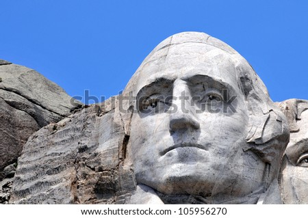 Closeup of former U.S. president George Washington at the Mount Rushmore National Memorial in South Dakota - stock photo