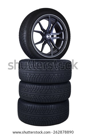 Closeup of four black tires stacked in the studio, isolated over white background - stock photo