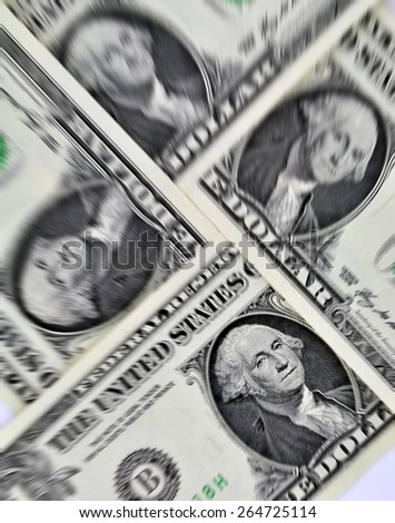 Closeup of four us dollar bills with added zoom effect - stock photo