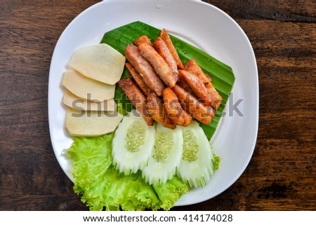 Closeup of fresh fried pork with sesame, thai food - stock photo