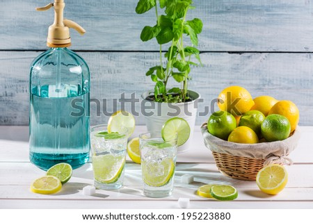 Closeup of fresh lemonade with fruit - stock photo