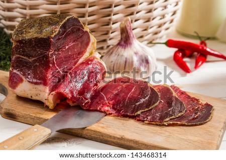 Closeup of fresh sliced prosciutto ham - stock photo