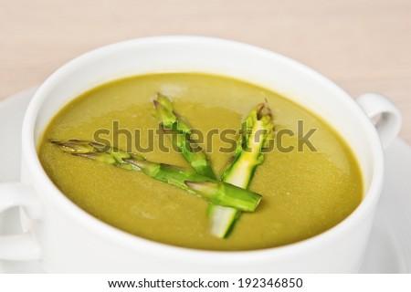 Closeup of fresh spring creamy asparagus soup - stock photo