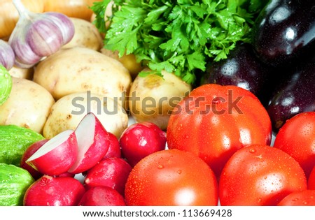 Closeup of fresh summer vegetables - background - stock photo
