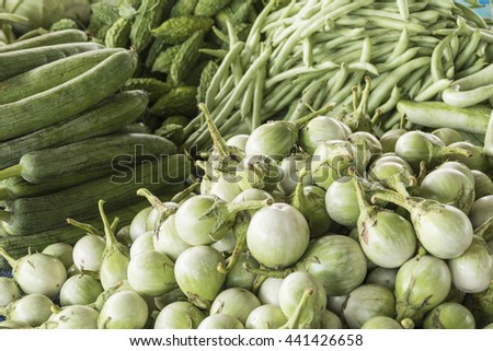 Closeup of fresh vegetables at local Thai market stall - stock photo