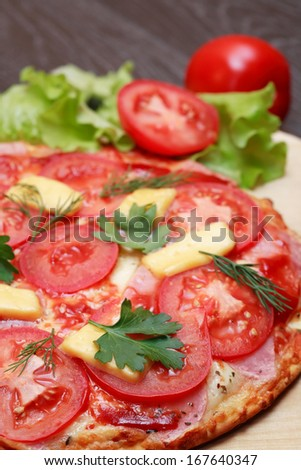 Closeup of freshness hot pizza on wooden board