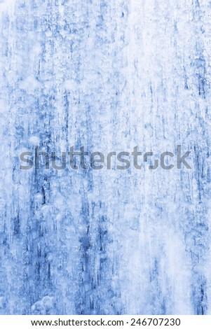 Closeup of frozen waterfall - stock photo