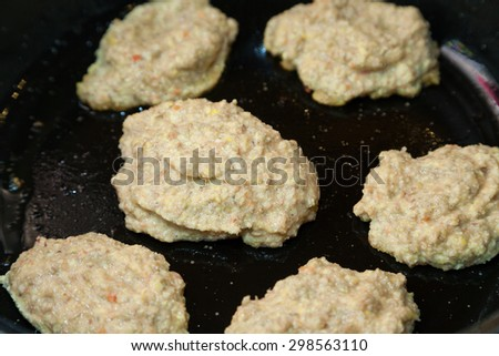 Closeup of frying vegetarian cutlets from lentil on frying pan - stock photo