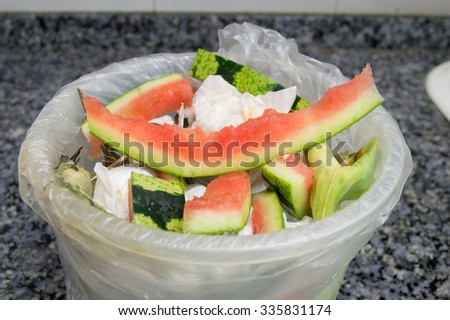 closeup of garbage bucket at the counter kitchen - stock photo