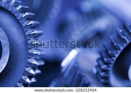 Closeup of gears, industrial mechanism  - stock photo