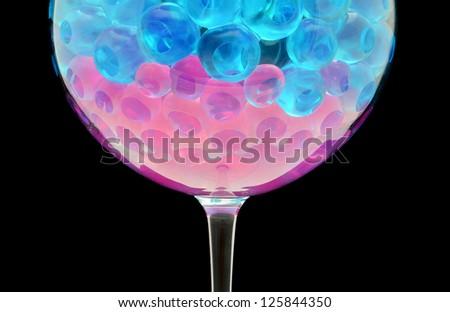 Closeup of gel bolls in glass - stock photo