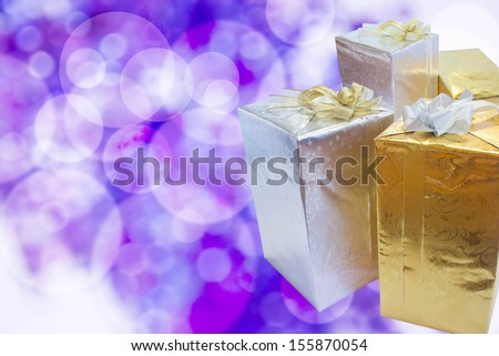 Closeup of gift boxes on abstract background