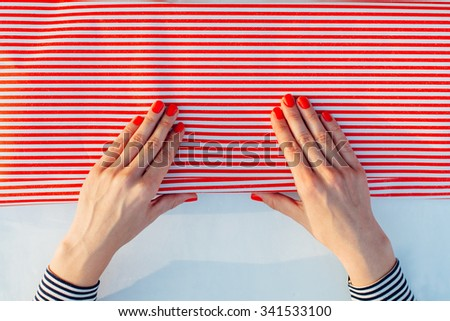 Closeup of Gift Wrapping. Woman packs gifts, step by step - stock photo
