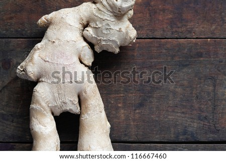Closeup of ginger root on dark wooden surface