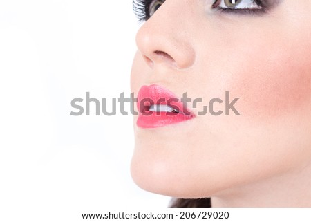 closeup of girl's beautiful nose and red lips isolated on white