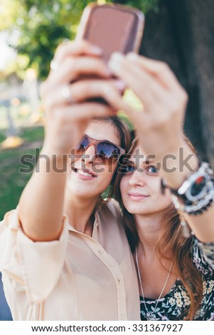 Closeup of girls taking self-portrait in the park