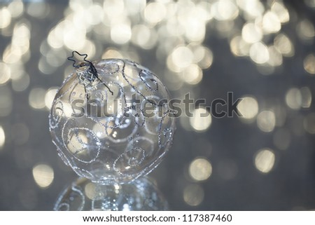 Closeup of glass Christmas ball on abstract background