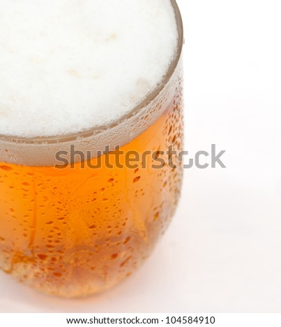 Closeup of Glass of Draught Beer on White Background - Shallow Depth of Field - stock photo