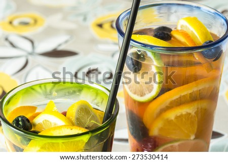 Closeup of glasses of assorted berries and fruits infused cold water.