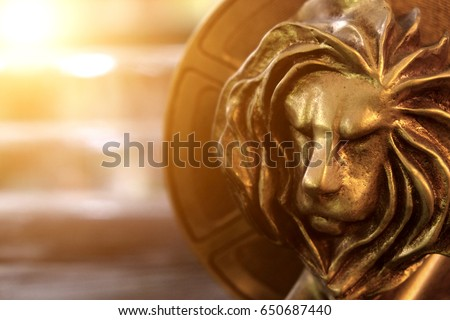 Closeup of gold cannes lion trophy, Shoot at Cannes lions festival 2016, France