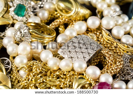 Closeup of gold jewelery with precious stones